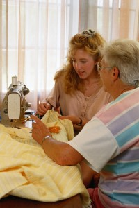 Senior and grandchild in assisted living facility